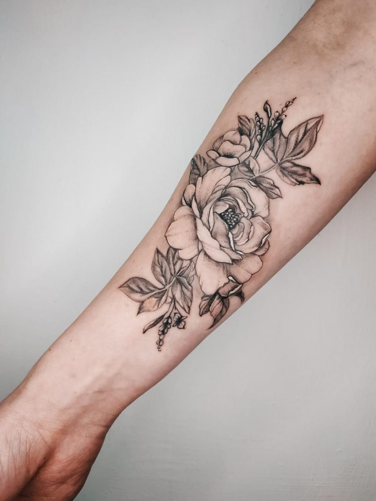 floral tattoo on a hand